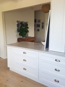 Classic White Kitchen. Shaker style doors.  Nordic Loft Caeserstone. Lime washed timber floors. V-joint ceiling.