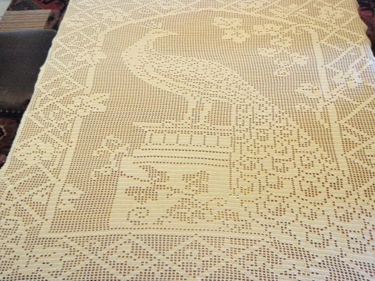 Peacock Tablecloth or window pane - This is a vintage pattern first published in the 1915′s Priscilla Needlework Book. The pattern is available through Dover Publications' 1979 Filet Crochet ISBN 0-486-23745-1 and shown on page 6 & 7.  This large rectangle insert for tablecloth has a grid of 127 horizontal by  178 vertical meshes.