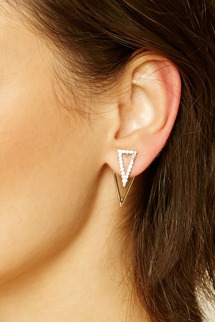 A pair of ear jackets featuring high-polish geo designs embedded with rhinestones and post backs.