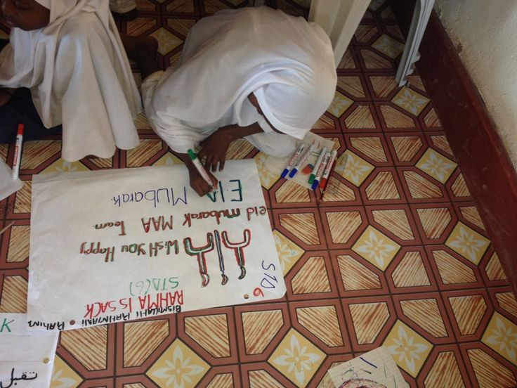 Muslim Aid Australia in KENYA. Some of our girls from the orphanage are making Eid Mubarak signs. They're a very creative and happy bunch masha'Allah!