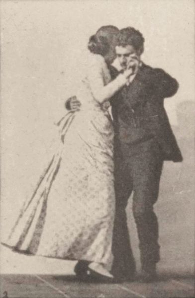 Man and woman dancing a waltz, 1887, public domain via Wikimedia Commons.