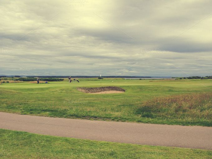 Check out Famous golf course in St Andrews by Patricia Hofmeester on Creative Market