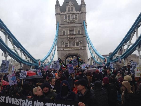 "Revolution News - London's March for Homes demonstrators cross Tower Bridge earlier.  Thousands of people gathered outside City Hall on Saturday to demand Boris Johnson urgently tackle the lack of affordable housing in the capital and curb the spiraling rents that they warn are ""ripping the heart"" out of London."