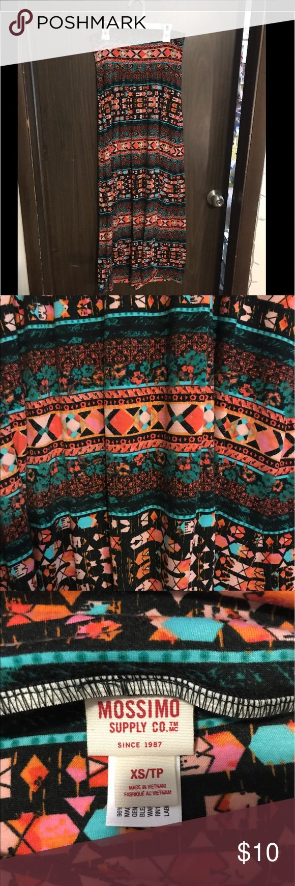 Rainbow Tribal Maxi Skirt Rainbow Tribal Maxi Skirt- LIKE BRAND NEW! Worn ONLY ONCE! Beautiful colors! Fold over waist like yoga pants! Matches with every color top! Very comfy material and slimming with the thick waist band! No defects! Bought from Target! Size XS Mossimo Supply Co Skirts Maxi