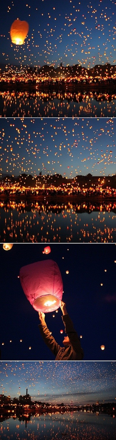 Sky full of lamps...wish lamps...guests write a wish on a piece of paper and then launch their wish into the sky...<3