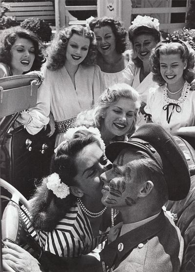 1944: John Farnsworth covered in kisses by famous pinups and actresses (L to R : Lynne Baggett , Dolores Moran , Barbara Hale ,Ginger Rogers, Gloria DeHaven , Chilli Williams and Jinx Falkenburg).