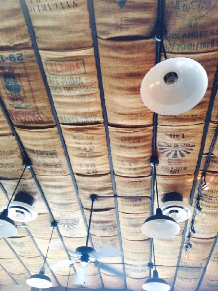 St Tropez Cafe, Bistro, and Wine Bar - San Diego, CA, United States. Cool ceiling. Covered with coffee burlap bags.