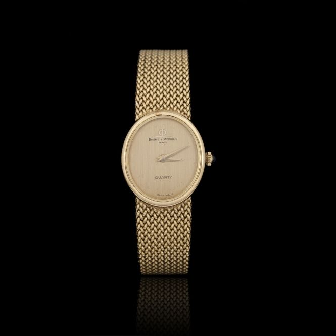 BAUM & MERCIER. Yellow-gold lady's bracelet watch, oval-shape, satin dial, quartz movement, braided bracelet.    Length: 16 cm (6-1/4 in.).    Overall weight: 47 gr. (1-1/2 oz.).