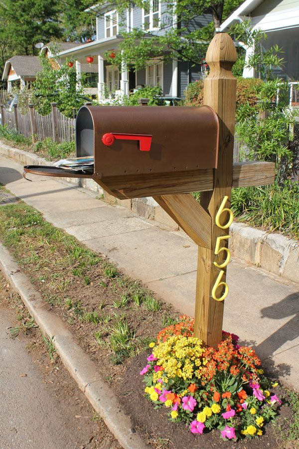 Raise your curb appeal with a mailbox garden bed that's packed with personality and color. We used orange and yellow kalanchoes, hot pink petunias, and sunny marigolds to perk up our post. What do you grow around your mailbox?