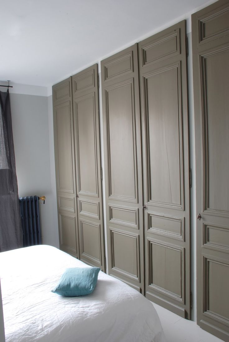 built-in closet with  paneled doors