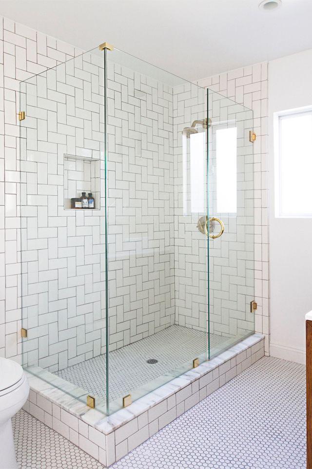 bathroom renovation // white subway tiles, glass shower doors, gold details