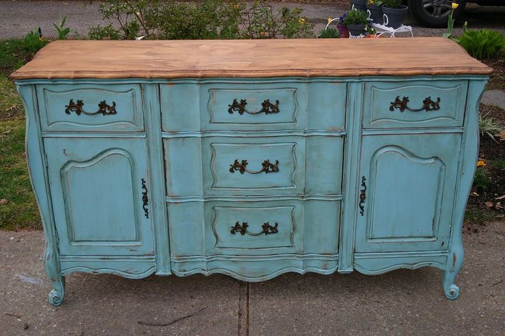 This sideboard was given a thorough sanding and the top was stripped using Citristrip brand safe stripper.