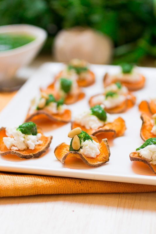 Impress your St. Patricks Day guests with this impressive bite sized appetizer: Baked Sweet Potato Chips with Goat Cheese and Cilantro