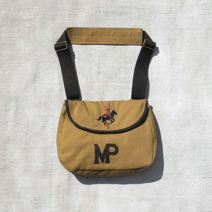 """VINTAGE MP RIDER DOGWALKING BAG by Red Canoe. Browse it... http://www.houndworthy.com/shop/people/dog-walking-bag-vintage-mp-rider-satchel/ """"Another great vintage inspired bag from Canadian Heritage Label Red Canoe, who make outdoors inspired gear from the golden age of bush pilot flying. This Mounted Police messenger satchel is perfect for dogwalkers."""""""