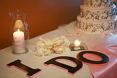 DIY decor on your cake table - buy these letters from your local craft store, spray paint in your favorite colors, add a candle for decoration - so easy!