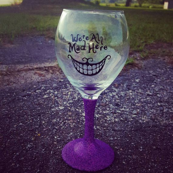 Check out this item in my Etsy shop https://www.etsy.com/listing/399577237/cheshire-cat-wine-glass-glitter-wine