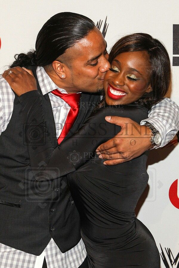 Jonathan Fatu {son of WWE wrestler Rikishi} kissing his fiancee Trinity McCray at a WWE event