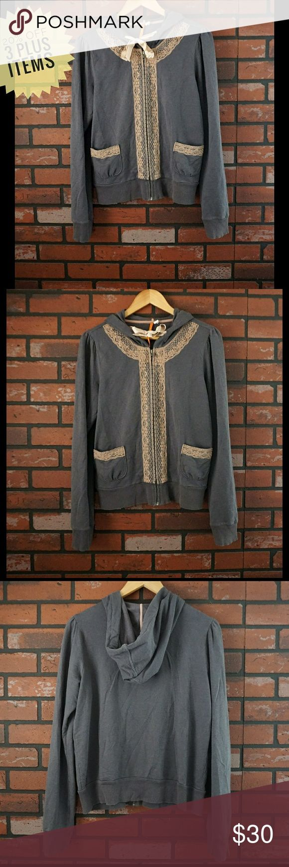 Anthropologie Sunday/Saturday Zip Hoodie. Anthropologie  Sunday Monday Tuesday Wednesday Thursday Friday Saturday  Zip Hoodie with Lace and Ribbon tie.  Size Large  61% cotton.   36% modal.   3% spandex.  Has some discoloration on the ribbon. Shown in last picture.   Approximate measurements all flat  Length 23.5 in. Bust 20 in. Shoulders 16 in. Stretches to 19 in. Sleeves 27.5 in. Anthropologie Tops Sweatshirts & Hoodies
