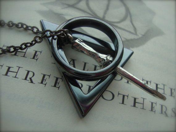 Deathly Hallows necklace. Just ordered this baby! Eeeeee!! <3 HP <3