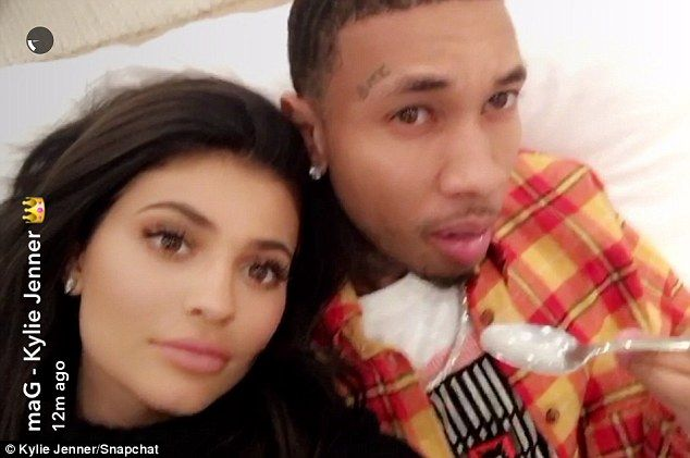 Lovebirds: Kylie posed for a Snapchat with her boyfriend Tyga while he tucked into some of the food she'd laid out