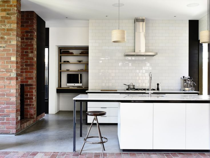 Red bricks and brick-shaped tiles work together to create the sturdiest-looking kitchen we've ever seen. Part of the Northcote Residence in Melbourne, Australia by Wolveridge Architects.