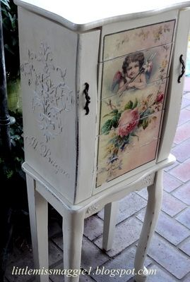 LittleMissMaggie: Romantic Jewelry Armoire using the mod podge transfer method and joint compound to achieve the raised plaster effect.