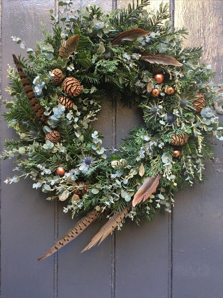 Luxury Christmas wreath incorporating pheasant feathers