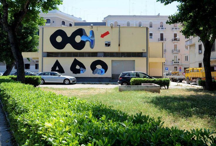 Una nuova opera d'arte a cielo aperto a Bari. Dopo il murales sulla facciata della caserma Rossani, ecco un dipinto sull'edificio dell'Acquedotto in piazza Diaz: è la nuova tappa del progetto della galleria Doppelgaenger che porta in città le opere di sei artisti urbani internazionalii