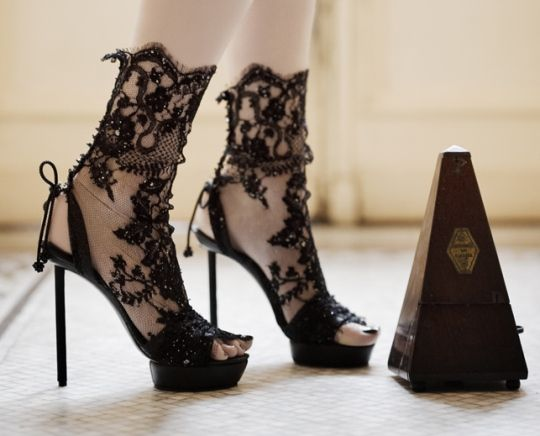 The  lace stilettos are the creation of shoe designer Vicente Rey, used on a photo shoot styled by Coppelia Pique and photographed by Andy Julia.