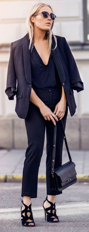 Angelica Blick + totally sleek + all black outfit + plunge neck tee + pair of fitted cigarette trousers + oversized one-button blazer + pair of striking stilettos  Jacket: Gina Tricot, Trousers: Sanne Alexandra, Shoes: Zara.