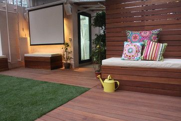 An outdoor projector screen on a rooftop garden by Alexandra Lauren Designs