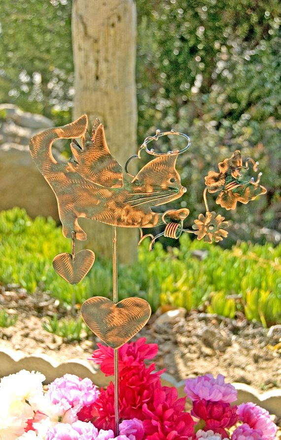 "Cat memorial metal yard art copper garden plant stake features an adorable cat angel that loves a butterfly. Created with artistic creative copper wire wrapping, a halo suspended overhead, angel wings, flower, hearts, one heart hanging from rear paw. This design is a one of a kind Garden Copper Art original, this sweetheart is now available for purchase. MEASURES: Please read measurements, thank you! ♥ Stake overall measures approximately 31"" in length from top of cat tail to bottom of the…"