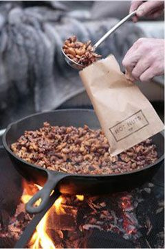 Roast some nuts in a cast iron pan over the fire pit. Maybe while deep frying the turkey?
