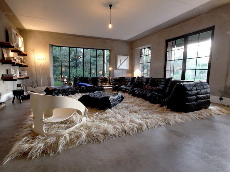 Love theTogo sofa by Ligne Roset...but pinned for that delightful rug!
