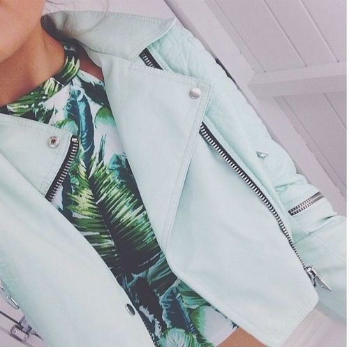 the green of the top looks so good against the baby blue leather jacket. Sick, fashionable look.