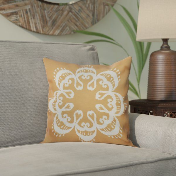 Looking for a way to add a curated touch to your home? Try tossing this eye-catching pillow on any open seat to add an effortless pop of pattern and global style. The elegant ikat mandala-inspired pattern on this accent pairs perfectly with large sunburst mirrors, vibrant throws, antiqued lanterns, and any other boho-chic decor. It also showcases a soft color palette and classic square shape, so it can blend into a variety of settings. Try tossing it on a reclaimed wood bench in your…