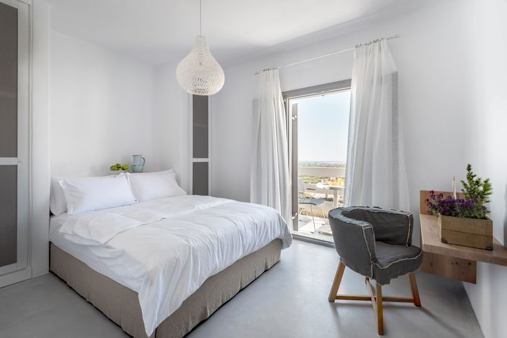 """The """"Seven"""" suite is located on the upper level of the complex and features a bedroom with king size double bed, a living room with sofa bed which accommodate up to 2 guests, a fully equipped kitchen and a spacious bathroom with shower cabin and WC. It also has 2 balconies and an outdoor terrace."""