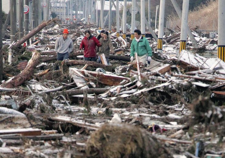 Earthquake in Japan - In Focus - The Atlantic People make their way through a street clogged with debris in Sendai city, Miyagi prefecture March 12, 2011. (REUTERS/Yomiuri)