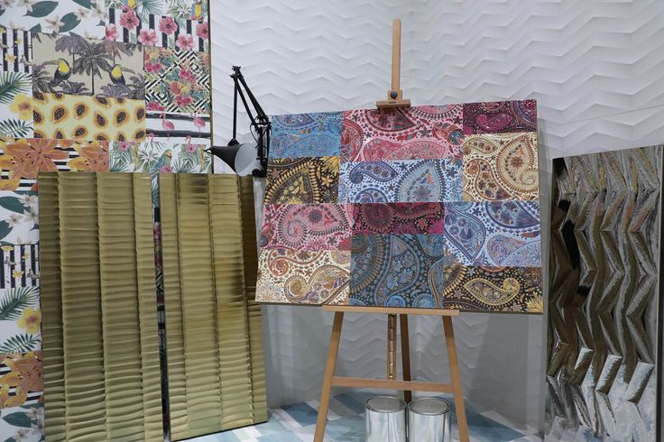 The stand of Aparici (Spain) is a colorful pasticcio of ethnic, pop art and paisley tile compositions out of the box.