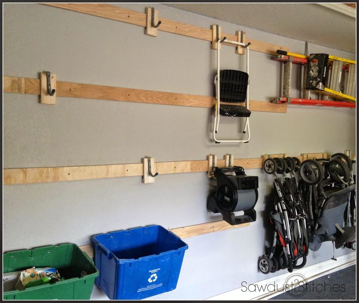 – Garage Storage.  Make this cleat storage system with hooks out of WOOD!!  SOOO much cheaper than the monkey bars brand!!