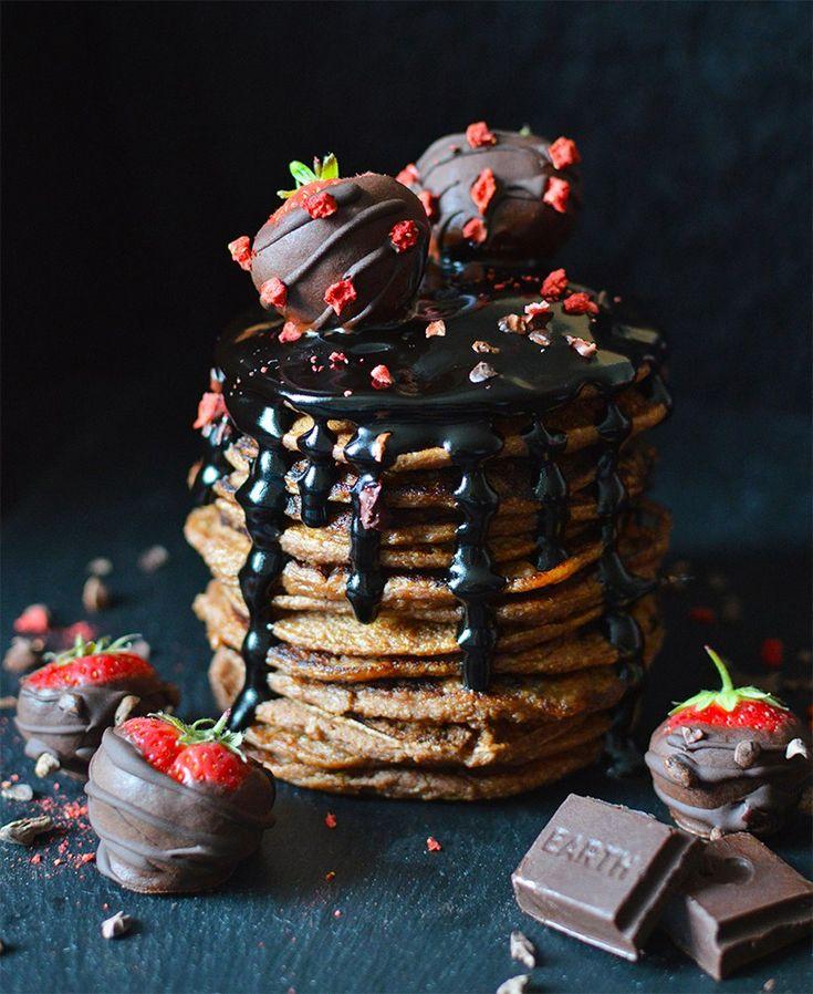 Vegan chocolate chip pancakes, served with raw carob fudge sauce and raw chocolate covered strawberries.