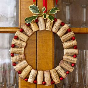 Add pop to a dining room with wine corks wired to tiny red jingle bells. Take about 22 corks of the same size and 22 small (3/8 of an inch) red bells bought from a crafts store. Drill a small hole (just big enough to fit your wire through) 1/4 of an inch from the top of each cork and another 1/4 of an inch from the bottom. It is very important to make sure all the drilled holes at the top line up with the holes at the bottom. Using long, green floral wire, push the wire though all the bottom…