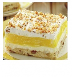 Luscious Lemon Delight - pecan shortbread crust, lemon pudding, a cream cheese layer, whipped cream.....yes please!
