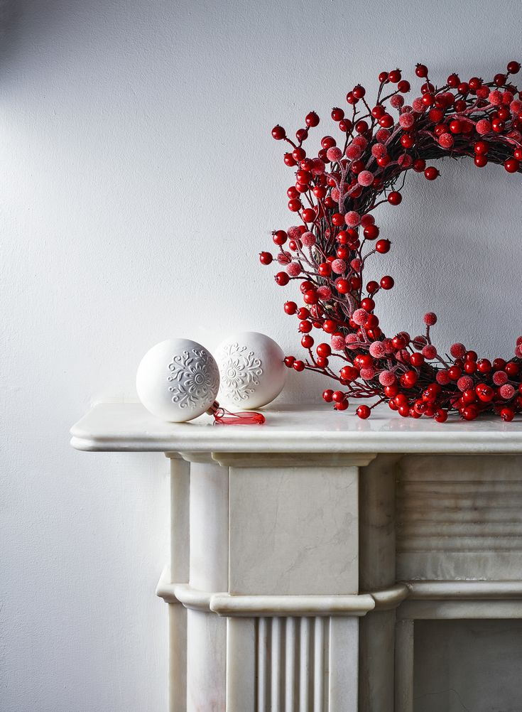 This wreath with its riot of red berry colour brings a dash of bright festive cheer to your door.