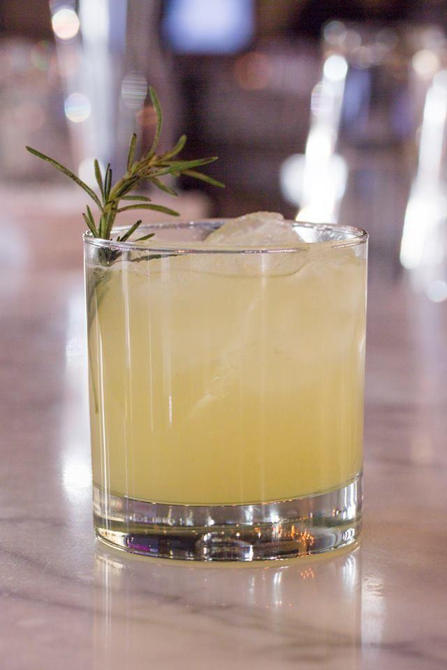 Bonnie Rose - ballantine's scotch, drambuie, orange juice, lemon juice and smoky rosemary — at Luma. #Toronto #restaurant #cocktails #food