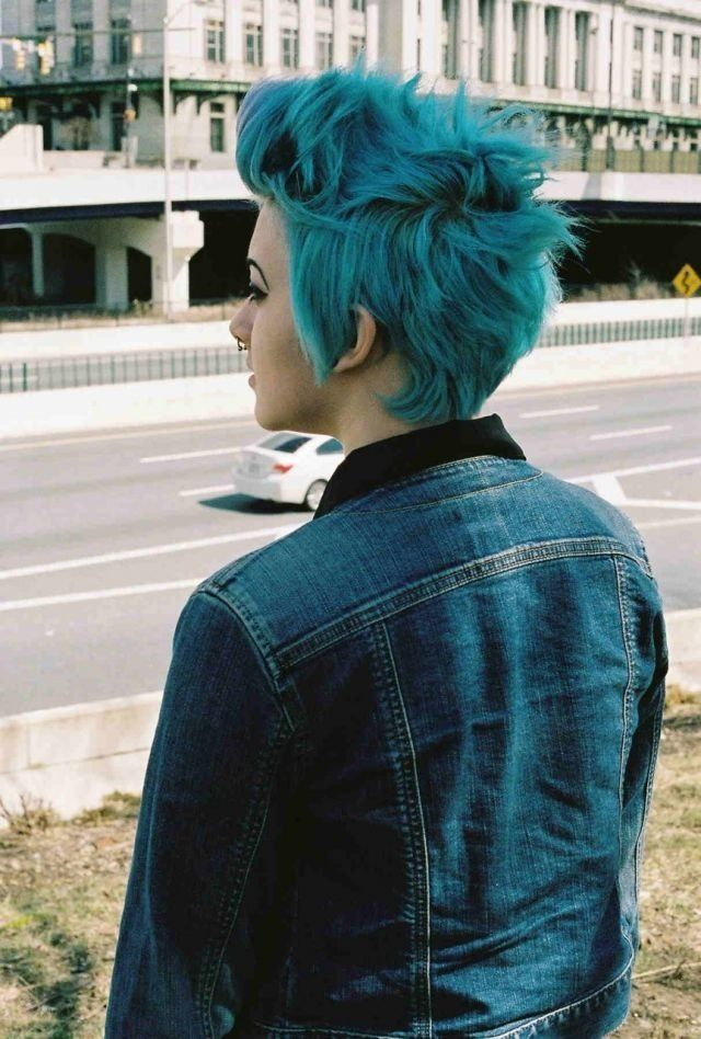 Short messy styled punk blue hair and septum piercing