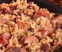 SMOKED SAUSAGE, BEANS & RICE.  -         2 T. butter   14 oz. smoked sausage, chopped   1 med. onion, chopped   1 clove garlic, minced   1 C. long grain rice, uncooked ...