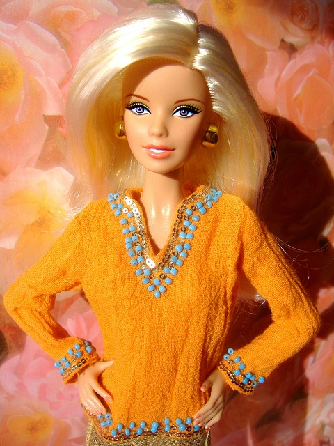 orange barbie  wants to know  if  there family trashed the house and haft a party? with there kids upstairs playing game when there mom said not to play game in tell there mom said so