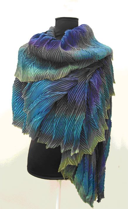 This is an Arashi Shibori Pleated Scarf made by Anne Selby. It's made up from six layers of lightweight silk and is called 'Peacock Stole'. To make the pleats Anne Selby steams and dry's the fabric. This piece stood out to me so much because it resembles peacock feathers so well. This really is a great fusion of textiles and technology because the balance is perfect.