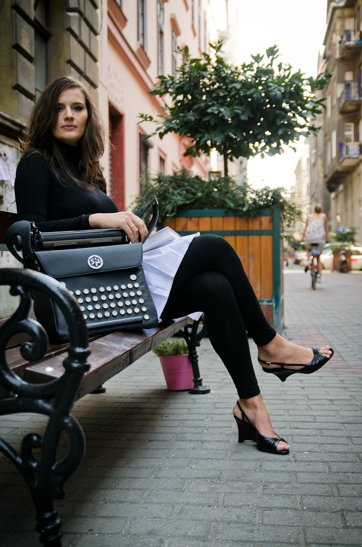 Noémi with a handbag (part of a typing machine) especially designed for her by her friend Rita.